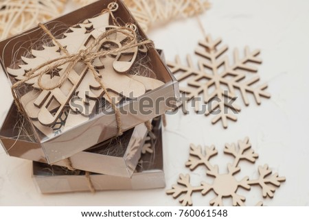 Parcel wrapped, gift box with brown kraft Paper. Laser cut Wooden Cristmas Decorations. Wooden Snowflakes #760061548