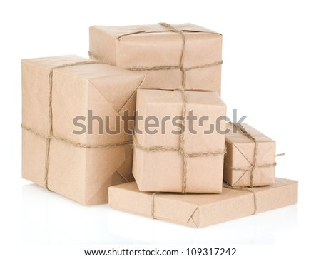 parcel wrapped with brown paper tied rope isolated on white background