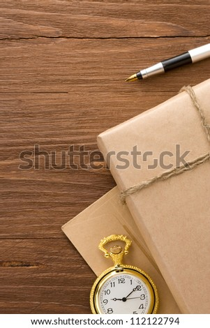 parcel wrapped with brown paper tied with rope on wood background