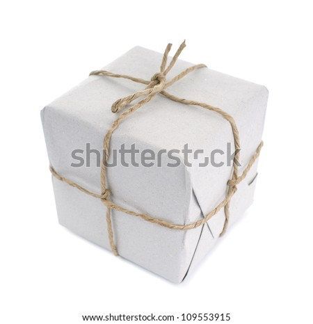 Parcel wrapped with paper, tied with string, isolated on white