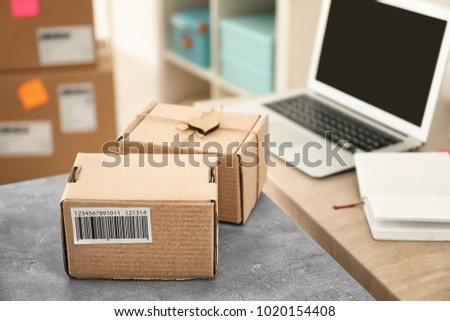 Parcels ready for shipment to customers on table in home office. Startup business #1020154408