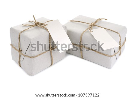 Parcels wrapped with  paper, tied with string and with blank label
