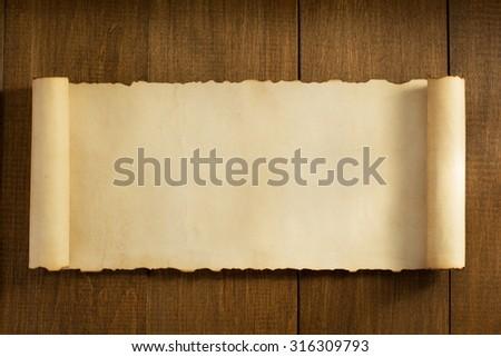 parchment scroll on wooden background ez canvas