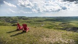 parcs canada Red chairs in grasslands national park, saskatchewan, canada