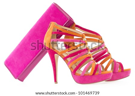 Pare of pink and orange shoes with a matching bag, isolate on white background