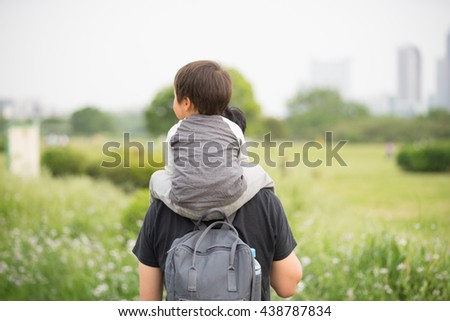 Parent and child to a piggyback
