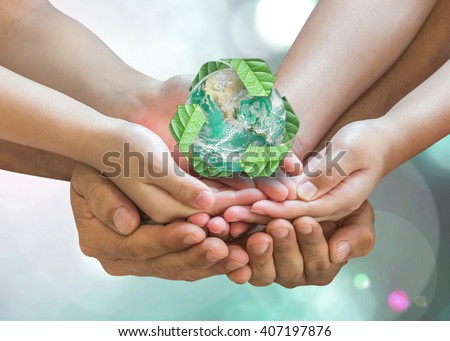 Parent and children holding together recycled green leaf sign planet on person hands on blur nature greenery background sun flare: Environment CSR ESG concept. Elements of this image furnished by NASA