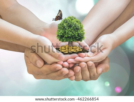 Parent and children planting together big tree with butterfly on family hands on gold coins soil ground: Retirement planning, financial investing, eco bio arbor CSR ESG ecosystem reforestation concept