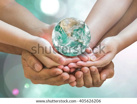 Parent and children together nurture holding green planet globe on person hands on blur nature greenery background sun flare: Environment CSR ESG concept. Elements of this image furnished by NASA