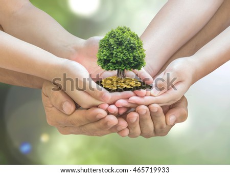 Parent children planting together big tree on family foster care hand, gold coin pile soil ground: Retirement planning financial investing charity eco bio arbor CSR ESG ecosystem reforestation concept