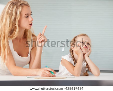 Parent Helps The Child To Do Homework. Sad Girl. Mother Swears Her ...