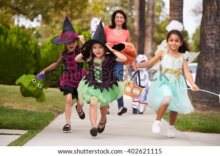 Parent Taking Children Trick Or Treating At Halloween #402621115
