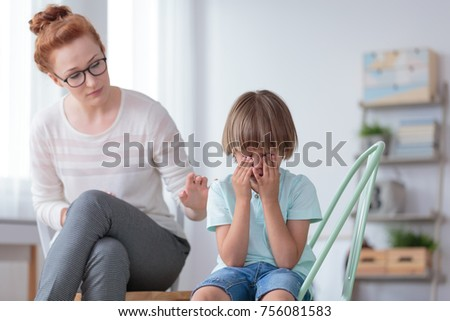 Parenthood and child development, young worried mother comforting little son crying at home