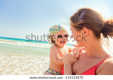 parenthood enjoying summertime outdoors in beach resort