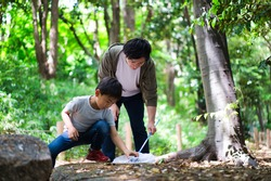 Parents and children catching bugs