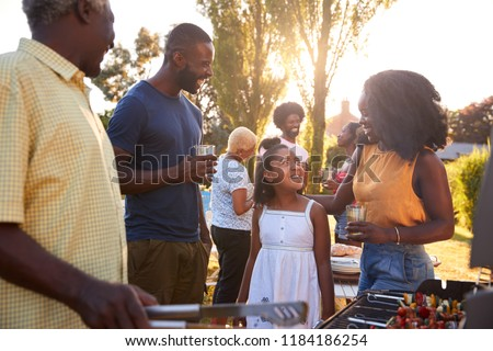 Parents and daughter at a multi generation family barbecue #1184186254