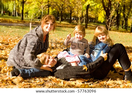 Parents and daughters in autumn park