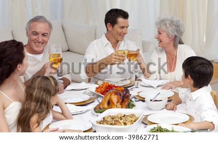 Parents and grandparents tusting with wine in a family dinner