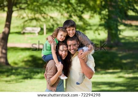 Parents giving children a piggyback