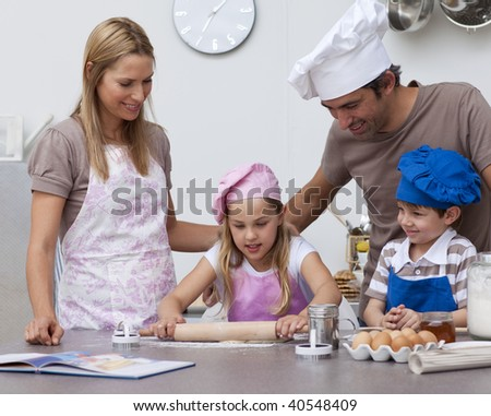 Parents helping children baking cookies in the kitchen