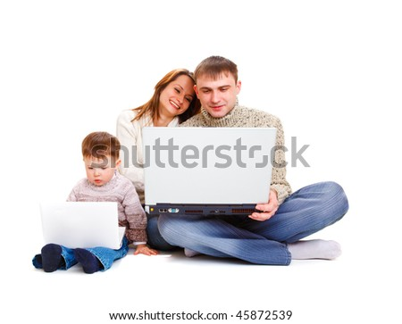 Parents holding large laptop, kid working with a small one