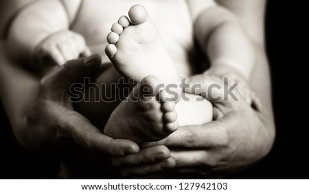 Parents holding their son - black and white photography