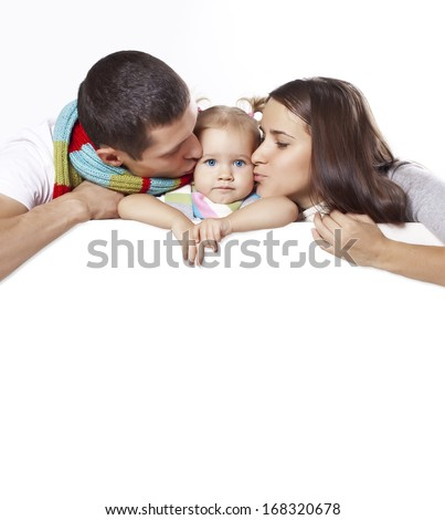 Parents kiss the child on the banner