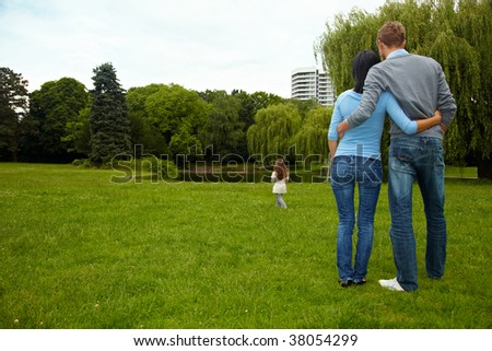 Parents looking after their daughter in a park