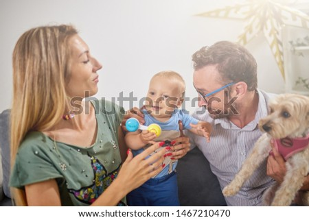 Parents playing with a baby at home.