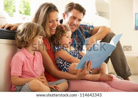 Parents Sitting With Children Reading Story Indoors #114642343