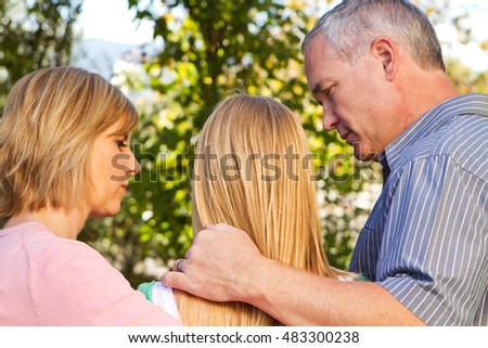 Parents talking with their teenage daughter. #483300238