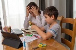 parents teaching kids at home, home school education, Mother helping her son to do homework