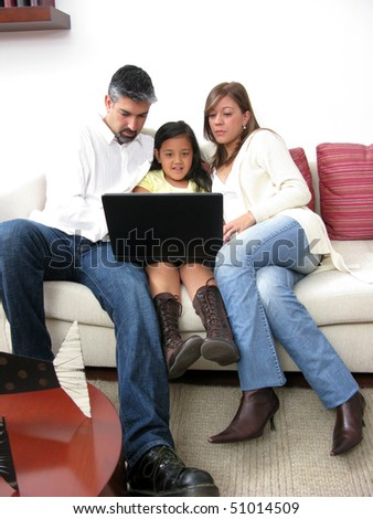 Parents whit son look in notebook on white background