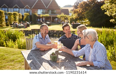 Parents With Adult Offspring Enjoying Outdoor Summer Drink At Pub #1190231614
