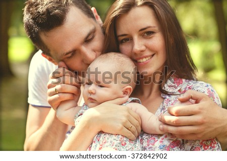 parents with baby in park