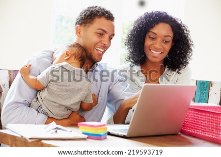 Parents With Baby Working In Office At Home #219593719