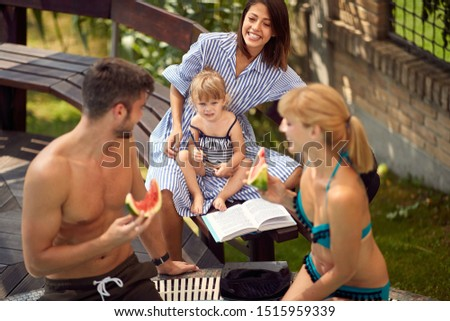 Parents with child and babysitter enjoying on summer outdoor