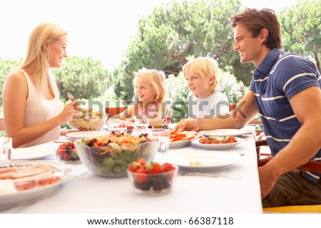 Parents, with children, enjoy a picnic