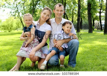 Parents with children together in the park
