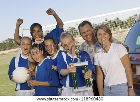 Parents with Daughter's Soccer Team and Trophy