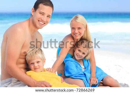 Parents with their children in their towels