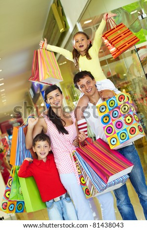 Parents with two children shopping in trade center - stock photo