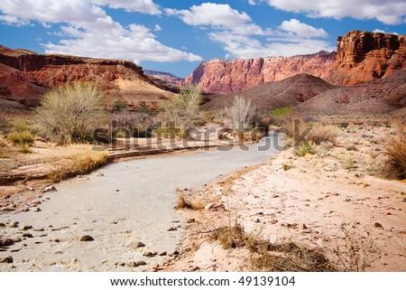 Paria River flowing through the base of the Vermillion Cliffs in desert landscape of Arizona