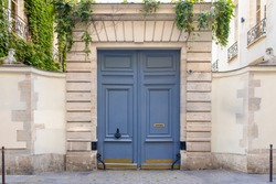 Paris, an old wooden door, typical building in the Marais