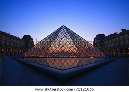 PARIS - APRIL 16: Landscape of Louvre museum at dusk during the Summer Exhibition April 16, 2010 in Paris.Louvre is the biggest Museum in Paris displayed over 60,000 square meters of exhibition space.