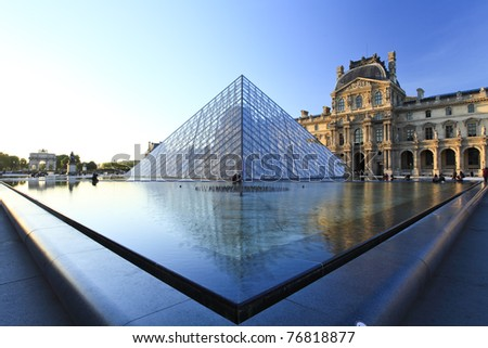 PARIS - APRIL 07: Louvre Pyramid shines at dusk on April 07, 2011 in Paris. Louvre is the biggest Museum in Paris displayed over 60,000 square meters of exhibition space.