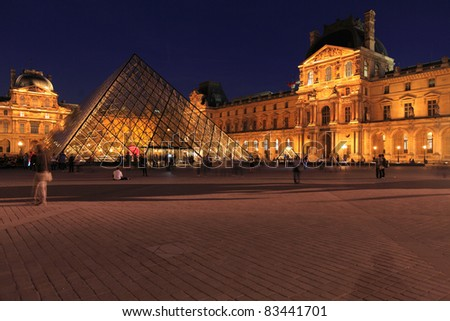 PARIS - APRIL 6: Night view of The Louvre Palace and the Pyramid on April 06, 2011 in Paris. Louvre is most visited museum in the world with 8.5 million visitors per year.