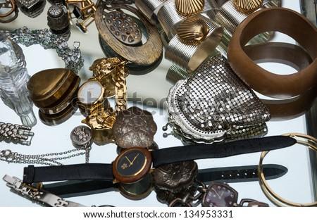 PARIS - APRIL 6: Old jewelry, accessories, watches etc  for sale at Saint Paul flea market on April 6, 2013 in Paris, France. This flea market serves the professional antique dealers.