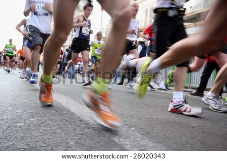 PARIS - APRIL 5: Participants compete in the annual Paris Marathon on April 5, 2009 in Paris. The race started at the Arch of Triumph with approximately 31,373 racers.