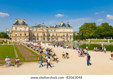 PARIS - APRIL 24: People enjoy sunny day in the Luxembourg Garden on April 24, 2011 in Paris. Luxembourg Palace is the official residence of the President of the French Senate.